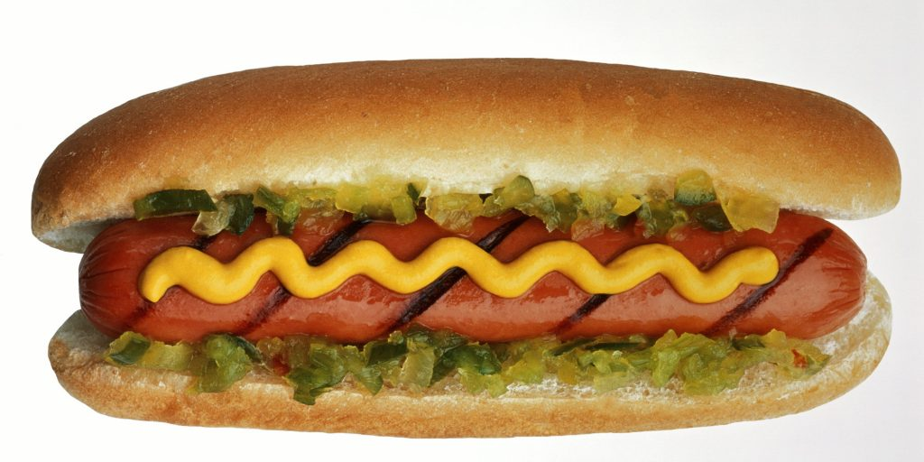 Hot dog in bun with mustard and relish, close-up (Enhancement)